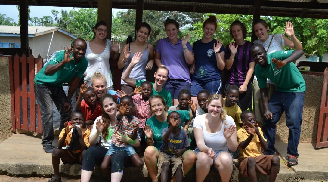 Interns and local staff in a group photo on our medical internship for teenagers in Ghana